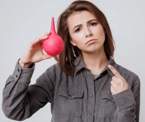 woman with an enema bulb